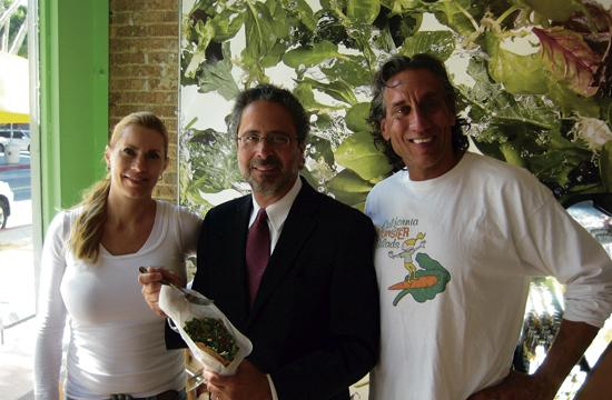 Mayor Richard Bloom (center) with California Monster Salads business partners Stacy Mahaffa and Daniel Radell with one of the salads served in a bread cone.