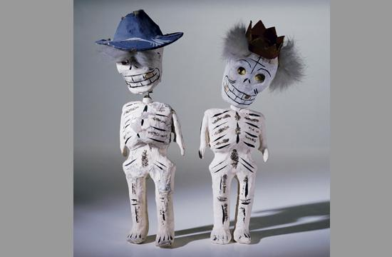 Calacas - whimsical skeleton figures that represent death.