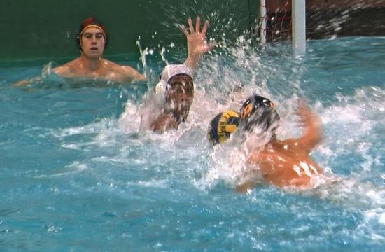 SaMoHi's Robert Staenberg reaches in to swat the ball from Culver City's Dario Fantella in SaMoHi's 9-8 overtime loss to the Centaurs on Wednesday.