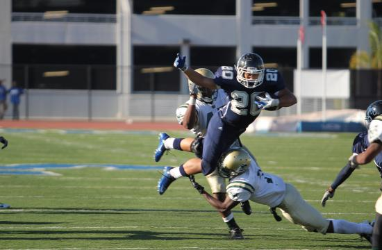 Daniel Pipken takes a carry to keep the clock running late in the fourth quarter of the Corsairs 26-22 win over LA Valley on Saturday.