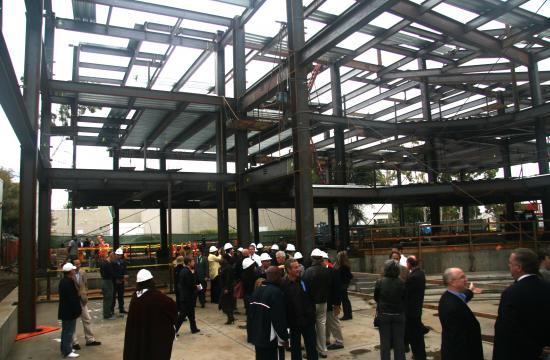 The completion of steel framing for the centerpiece Performing Arts and Leadership Center was celebrated today.