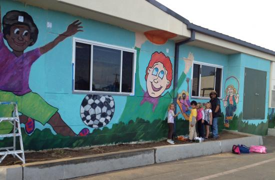 Facing the playground is the second mural designed to promote cultural awareness and bully prevention education.