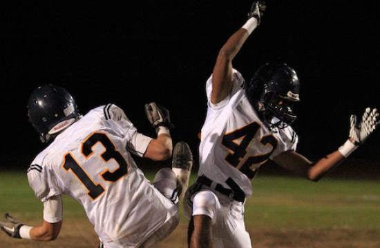 SaMoHi's Matt Rus-kosa and Vishal Jittu celebrate as the Vikings brought home their first Ocean League title in 10 years with their 17-14 victory over Culver City on Friday night.