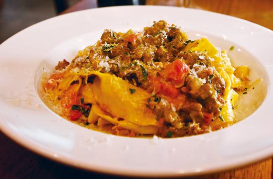 The Pappardelle with Italian Sausage ($12.95) is the Louise's Trattoria's specialty dish at its Santa Monica location.