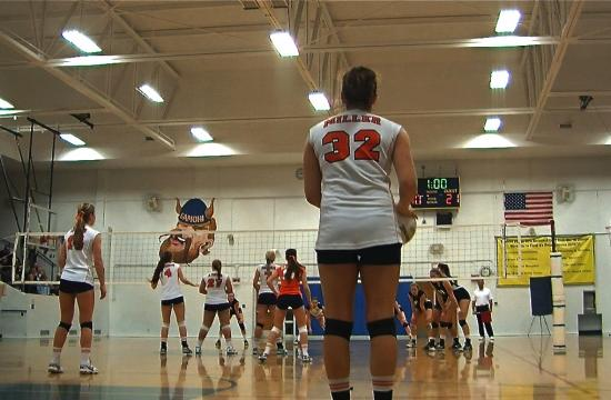 Poly's Michelle Miller prepares to serve against Samohi in the second set of the Panthers' sweep on Tuesday.