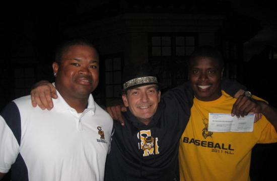 Samohi baseball coaches Sheldon Philip-Guide (left) and Tony Todd (right) pose with Samohi alumnus Charlie Sheen with Sheen's $10