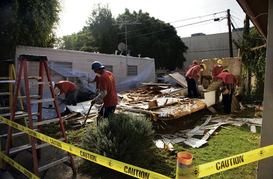 Construction workers commenced the demolition of 10 unoccupied trailers at the Village Trailer Park on Wednesday.