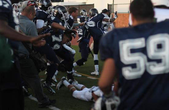 Coaches and players try to break up the brawl that broke out after East LA's 42-28 victory over SMC in the American Bowl Championship on Saturday.