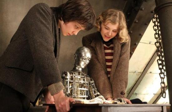 "Chloë Grace Moretz and Asa Butterfield and the automaton in ""Hugo""."