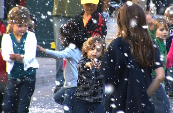 Children play in the snow at the Third Street Promenade on Tuesday to get a jumpstart on the holidays for Downtown Santa Monica's WinterLit celebration.