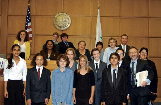 The JAMS mock trial team with their coaches and the acting judge.