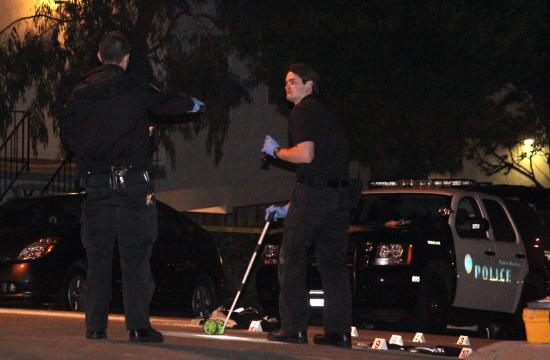 Santa Monica police gather evidence at the crime scene in Tuesday's shooting at 600 Pacific Street.