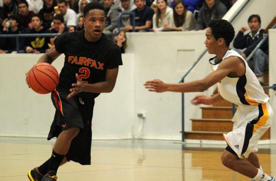 Fairfax's Landon Drew goes one-on-one with Samohi's Trevis Jackson in the Lions' 45-41 win on Wednesday.
