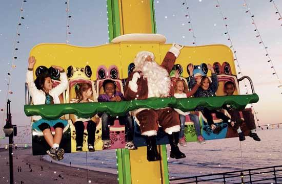 A lifelike Santa Claus will be taking center seat every ride on the Frog Hopper At Pacific Park through Christmas Day.