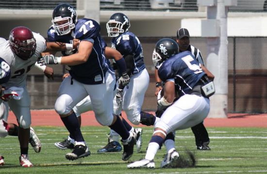 SMC offensive tackle Alexandru Ceachir (77) clears a hole for running back Alonzo Frederick against Compton early in the 2011 season. Ceachir committed to play football for Utah next season.