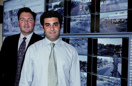 Sam Morrissey (left) and Andrew Maximous in front of the video wall at the City's new Transportation Management Center