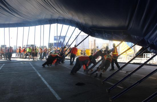 The blue and yellow Grand Chapiteau tent was raised next to the Santa Monica Pier today in preparation for the first show on Jan. 20.