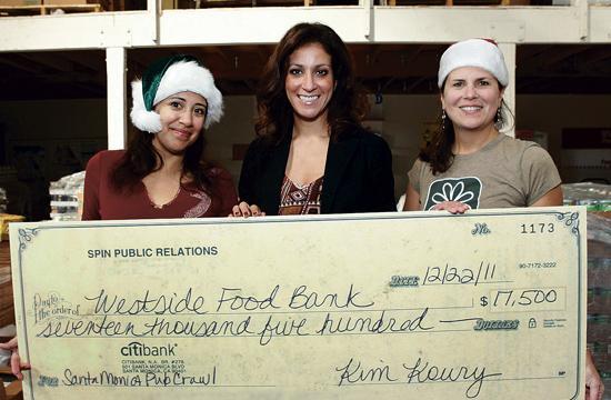 SANTA Monica Pub Crawl organizer Kim Koury (center) raised $17