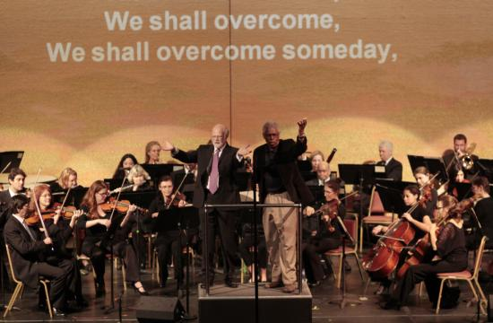 """Maestro Gross and the MLK Westside Coalition's Nat Trives led the crowd in the traditional singing of """"We Shall Overcome"""" to honor the work of Dr. King on Sunday."""