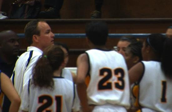 Samohi girls' basketball coach Marty Verdugo prepares his team in the final minutes of their game against Hawthorne on Wednesday night.