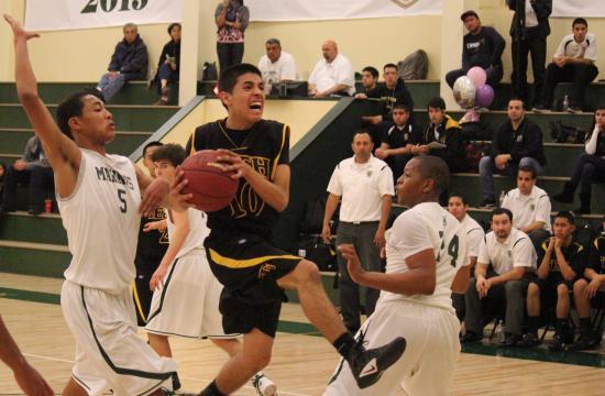 Bosco Tech's Steven Lara breaks for the basket against St. Monica on Monday night.