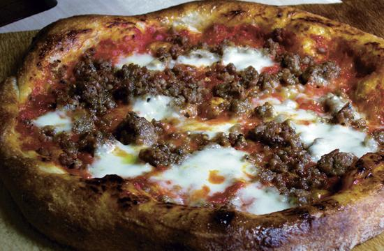 The housemade organic Italian sausage pizza.