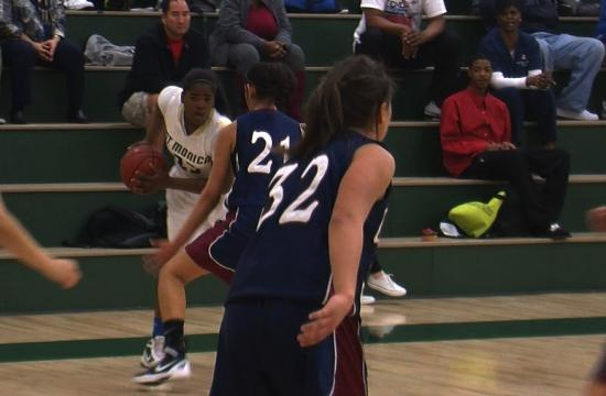 St. Monica's Briana Harris makes a move against the Cantwell-Sacred Heart defense in Thursday night's win.
