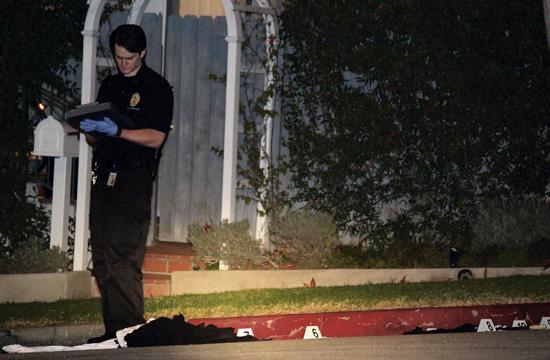 A SMPD detective collects evidence on Dec. 6