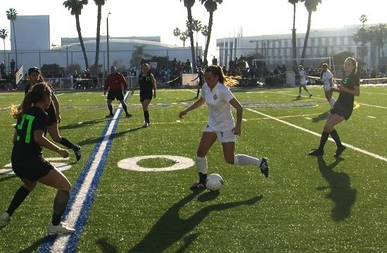 The South Torrance defense swarms Samohi's Lidia Battaglia in the Lady Spartans' 3-0 win on Wednesday.