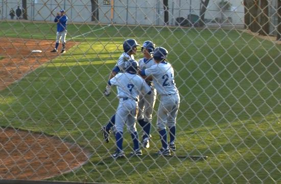 Agoura's Tyler Cohen jumps into the arms of his teammates while scoring the insurance run against Samohi on Tuesday.