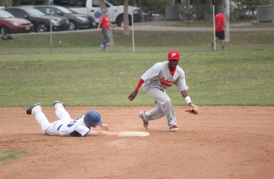Crossroads' Cooper Halpern slides back to second after Paraclete's Mylz Jones snags an errant throw in the Spirits' 6-2 win on Thursday.