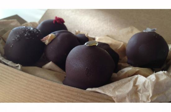 Le Marais Chocolat is small batch hand-dipped truffles from organic Fair Trade chocolate with a portion of proceeds going to support orphanages in Haiti.