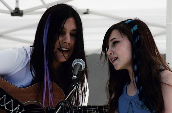 Jacqueline Mackenzie (right) will perform at The Talking Stick Coffee Lounge this Sunday to raise funds for the John Adams Middle School Science Magnet Scholarship Fund. She is pictured with her mom Liane Curtis.