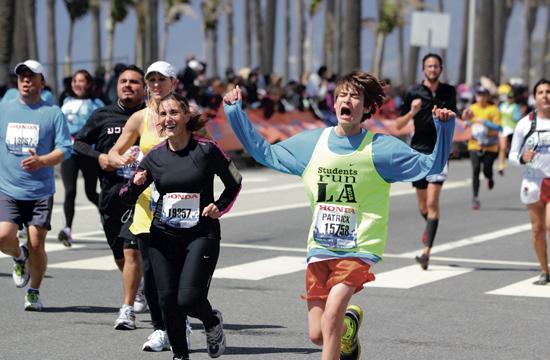 A jubilant runner crosses the finish line at last Sunday's LA Marathon