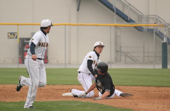 Samohi's Nobu Suzuki tags out Peninsula's Michael Green in the third inning of the Vikings' 9-6 loss on Thursday.