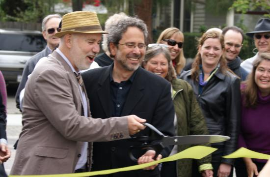 Borderline Neighborhood Improvement Committee Chair Dennis Woods (left) and Mayor Richard Bloom cut the ribbon on the Borderline Shared Streets Project.