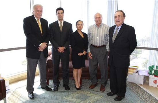Connolly Oyler (far right) with members of his family law practice at Oyler and Woldman. The firm