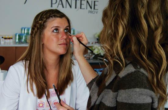 A makeup artist demonstrates one of the products on display at the Fashion and Beauty Blog conference at the Annenberg Community Beach House on April 30.