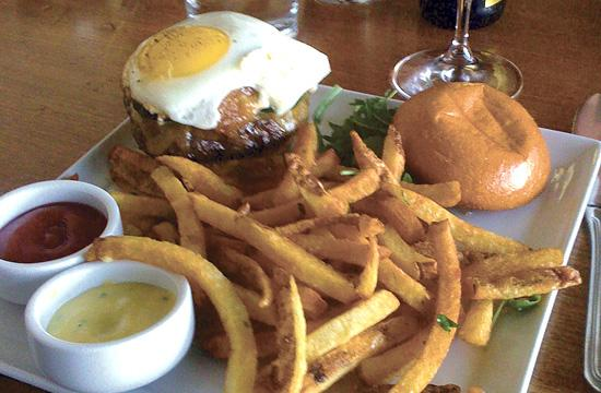 Rustic Canyon's Niman Ranch Burger with Fried Egg and French fries. Best served medium rare.