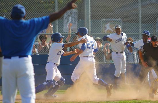 Culver City's Pablo Saucedo is mobbed by his Centaur teammates after scoring the game- and league-winning run against Samohi on Thursday.