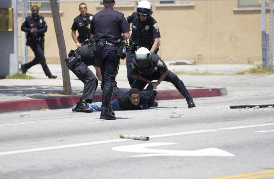 The suspect jumped off the roof and onto Pico Boulevard after about 30 minutes of police negotiations.