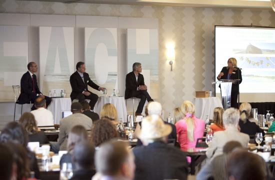 SMCVB President/CEO Misti Kerns moderates a panel of travel industry leaders at Santa Monica's 3rd Annual Travel and Tourism Summit on Wednesday