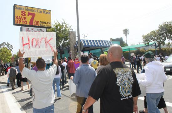 """A rally was held this morning to protest """"unlawful labor policies"""" at three local car wash facilities"""