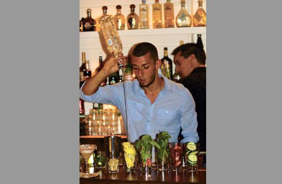 Mauricio Ortega crafts a cocktail at the recently opened SHOREbar.