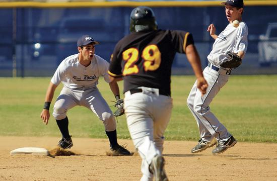 New Roads Franky Bernstein (left) and Spencer Backlar (right) try to recover an error in the seventh inning.