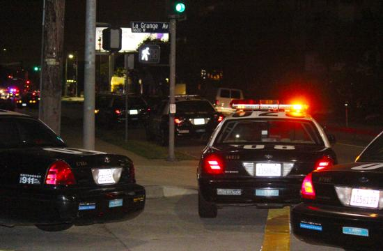 Police close down a block along Barrington from Mississippi to La Grange Thursday night after reports of a gunman.