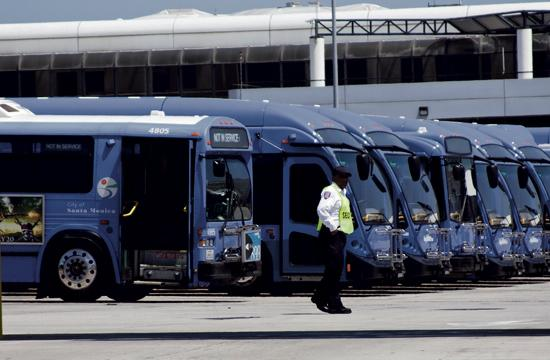 A fleet of Big Blue Buses sitting at the facility headquarters. Changes will be implemented to Route 2 and Rapid 10 in August.