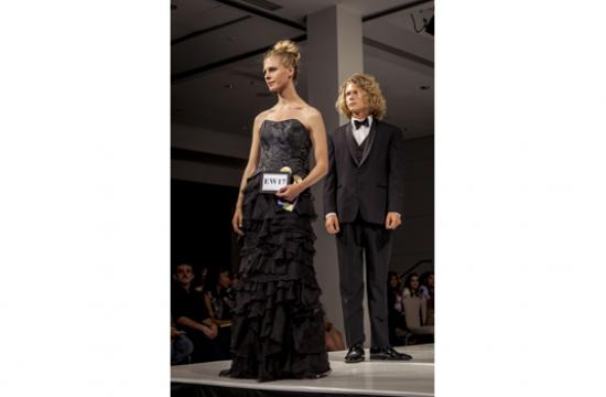 "Santa Monica College student Inken Brough won a $500 Scholarship Award from the Textile Association of Los Angeles in association with the California Fashion Foundation for her structured-and-layered evening gown. She is shown modeling her Best in Show design in ""LA Mode 2012"