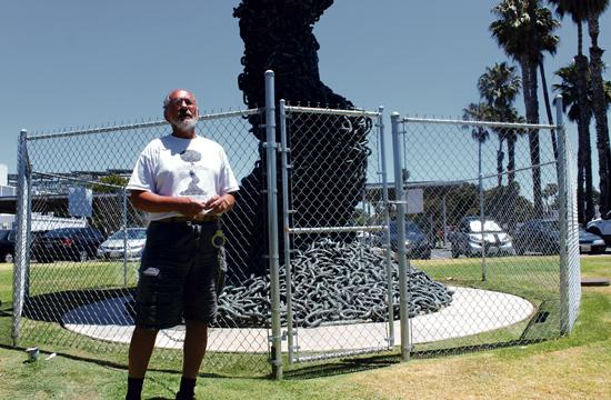 """Santa Monica activist Jerry Rubin began a 10-week liquid fast Tuesday after symbolically chaining himself to the sculpture """"Chain Reaction"""