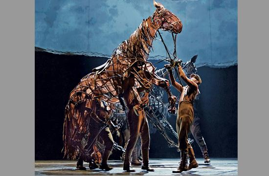 "Puppeteers manipulate horses ridden in ""War Horse"